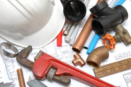 Plumbing parts, tools, and plans used by Kevin Ginnings Plumbing Service Inc..